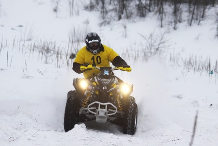 KYIV, UKRAINE - 13 FEBRUARY 2010: The quad bikes driver Roman Balykin (Kawasaki) rides over snow track during Baja Kyiv-2010 Rally on 13 Feb, 2010 in Kyiv