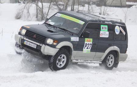 KYIV, UKRAINE - 13 FEBRUARY 2010: Ukraine Racing Teams crew on Mitsubishi Pajero rides over snow track during Baja Kyiv-2010 Rally on 13 Feb, 2010 in Kyiv