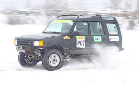 KYIV, UKRAINE - 13 FEBRUARY 2010: Ukraine Racing Teams crew on Land Rover rides over snow track during Baja Kyiv-2010 Rally on 13 Feb, 2010 in Kyiv