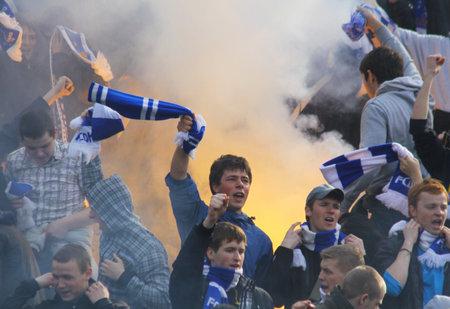 ultras: KYIV, UKRAINE - MARCH 28, 2010: FC Dynamo Kyiv ultras (ultra supporters) burn a flares during Ukraine Championship game against Metalist Kharkiv on March 28, 2010 in Kyiv, Ukraine