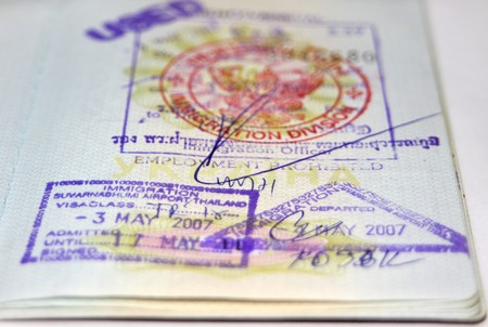 Page of passport with Thailand visa and stamps Stock Photo - 7971442