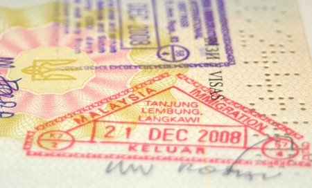 Page of passport with Malaysian customs stamps photo