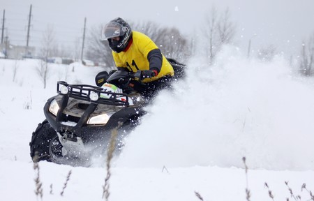 KYIV, UKRAINE - 13 FEBRUARY 2010: The quad bikes driver Roman Maksymenko (Honda) rides over snow track during Baja Kyiv-2010 Rally on 13 Feb, 2010 in Kyiv