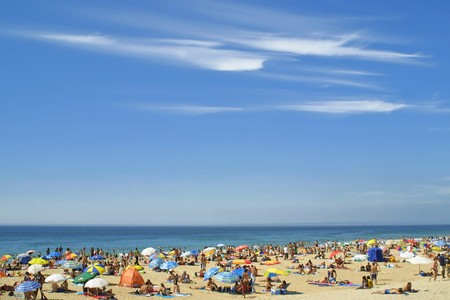 Crowded Atlantic summer beach near Carcavelos, Portugal photo