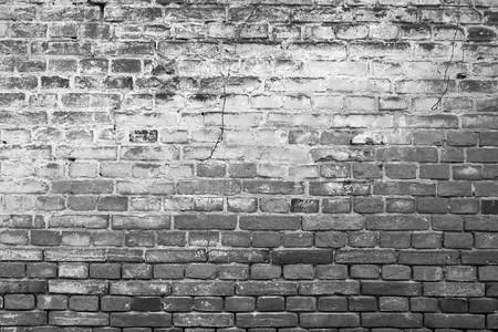 Ancient brickwall background, black/white Standard-Bild