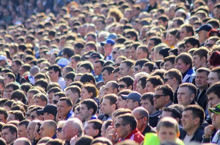 KYIV, UKRAINE - APRIL 18, 2010: People watch the football game of Ukraine Championship between FC Dynamo Kyiv and FC Dnipro on April 18, 2010 in Kyiv, Ukraine Stock Photo - 8076077