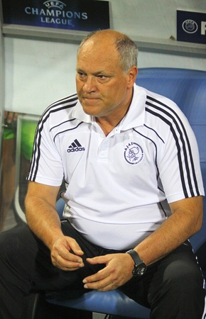 playoff: KYIV, UKRAINE - AUGUST 17, 2010: The head coach of AFC Ajax Martin Jol looks on during UEFA Champions League play-off game against FC Dynamo Kyiv on August 17, 2010 in Kyiv, Ukraine