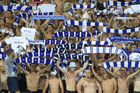 ajax: KYIV, UKRAINE - AUGUST 17, 2010: FC Dynamo Kiev team supporters show their support during their UEFA Champions League play-off game against AFC Ajax on August 17, 2010 in Kyiv, Ukraine