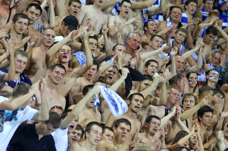 dynamo: KYIV, UKRAINE - AUGUST 17, 2010: FC Dynamo Kiev team supporters show their support during their UEFA Champions League play-off game against AFC Ajax on August 17, 2010 in Kyiv, Ukraine