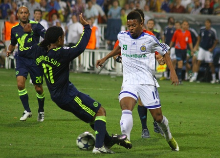 ajax: KYIV, UKRAINE - AUGUST 17, 2010: Andre of Dynamo Kyiv (R) fights for a ball with Urby Emanuelson of AFC Ajax during their UEFA Champions League play-off game on August 17, 2010 in Kyiv, Ukraine