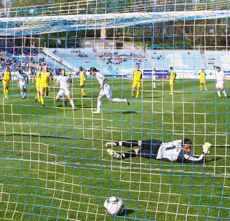 KYIV, UKRAINE - MAY 01, 2010: Artem Milevskyy of Dynamo Kyiv scores the penalty during Ukraine Championship game against Zakarpattya Uzhgorod on May 1, 2010 in Kyiv, Ukraine