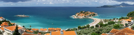 Panoramic view of Sveti Stefan (St. Stefan) island in Adriatic sea, Montenegro photo