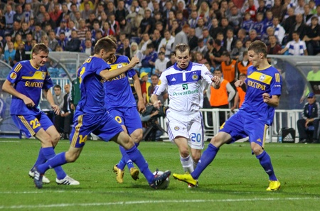gusev: KYIV, UKRAINE - SEPTEMBER 16, 2010: Oleg Gusev of Dynamo Kyiv (in White) fights for the ball with FC BATE players during their UEFA Europa League game on September 16, 2010 in Kyiv, Ukraine