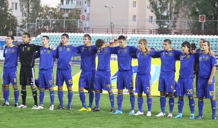 hymn: KYIV, UKRAINE - SEPTEMBER 3, 2010: Players of Ukraine (Under-21) National team sing the hymn before UEFA European Under-21 Championship qualifying game against France on September 3, 2010 in Kyiv, Ukraine