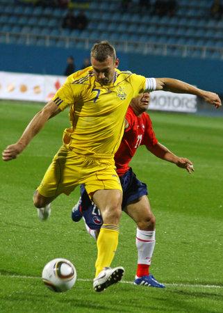 KYIV, UKRAINE - SEPTEMBER 7, 2010: Andriy Shevchenko of Ukraine (in yellow) kicks the ball during friendly game against Chile on September 7, 2010 in Kyiv, Ukraine Stock Photo - 8607797