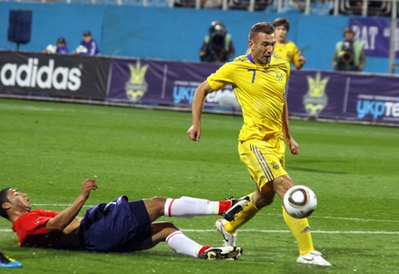 KYIV, UKRAINE - SEPTEMBER 7, 2010: Andriy Shevchenko of Ukraine (in yellow) controls the ball during friendly game against Chile on September 7, 2010 in Kyiv, Ukraine Stock Photo - 8607796