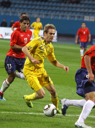 KYIV, UKRAINE - SEPTEMBER 7, 2010: Marco Devic of Ukraine (in yellow) controls the ball during friendly game against Chile on September 7, 2010 in Kyiv, Ukraine  Stock Photo - 8607795