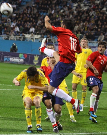 KYIV, UKRAINE - SEPTEMBER 7, 2010: Players of Ukraine and Chile fight for the ball during during their friendly football game on September 7, 2010 in Kyiv, Ukraine Stock Photo - 8607856