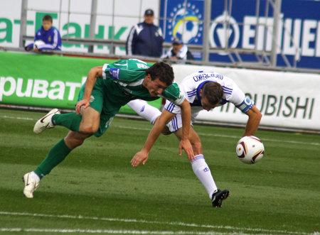 KYIV, UKRAINE - OCTOBER 16, 2010: Andriy Shevchenko of Dynamo Kyiv (R) fights for the ball with Artem Fedetskyy of Karpaty Lviv (L) during their Ukraine Championship on October 16, 2010 in Kyiv, Ukraine Stock Photo - 8626284