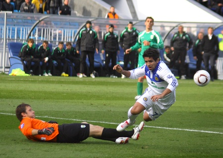 KYIV, UKRAINE - OCTOBER 16, 2010: Guilherme of Dynamo Kyiv (R) fights for the ball with goalkeeper Vitaly Rudenko of Karpaty Lviv (L) during their Ukraine Championship on October 16, 2010 in Kyiv, Ukraine