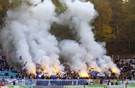 ultras: KYIV, UKRAINE - OCTOBER 16, 2010: FC Dynamo Kyiv ultras (ultra supporters) burn flares during Ukraine Championship game against FC Karpaty Lviv on October 16, 2010 in Kyiv, Ukraine