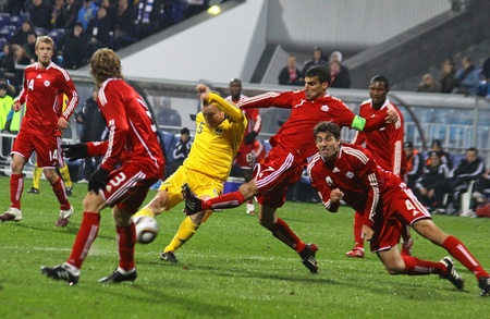 KYIV, UKRAINE - OCTOBER 8, 2010: Oleg Gusev of Ukraine (in yellow) fights for a ball with Canadian footballers during their friendly game on October 8, 2010 in Kyiv, Ukraine Stock Photo - 8728688