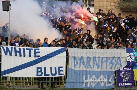 LUTSK, UKRAINE - OCTOBER 24, 2010: FC Dynamo Kyiv ultras (ultra supporters) burn flares during Ukraine Championship game against FC Volyn on October 24, 2010 in Lutsk, Ukraine