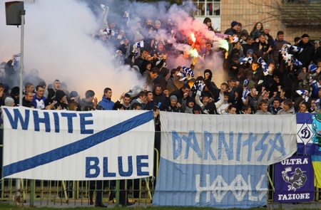 ultras: LUTSK, UKRAINE - OCTOBER 24, 2010: FC Dynamo Kyiv ultras (ultra supporters) burn flares during Ukraine Championship game against FC Volyn on October 24, 2010 in Lutsk, Ukraine