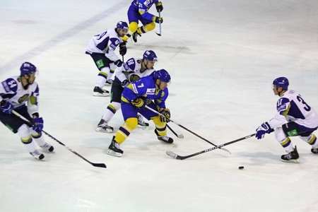 KYIV, UKRAINE - DECEMBER 18, 2010: Prime Euro Hockey Challenge game between Ukraine and Kazakhstan on December 18, 2010 in Kyiv, Ukraine Stock Photo - 8780045
