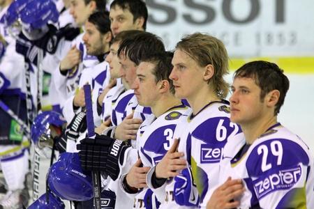 hymn: KYIV, UKRAINE - DECEMBER 18, 2010: Kazakhstan ice-hockey national team are listening the hymn after Prime Euro Hockey Challenge game against Ukraine on December 18, 2010 in Kyiv, Ukraine