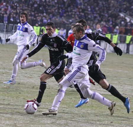 gusev: KYIV, UKRAINE - FEBRUARY 24, 2011: Oleg Gusev of Dynamo Kyiv (in white) fights for a ball with Besiktas players during their UEFA Europa League game on February 24, 2011 in Kyiv, Ukraine