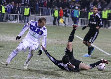 gusev: KYIV, UKRAINE - FEBRUARY 24, 2011: Oleg Gusev of Dynamo Kyiv (L) fights for a ball with Roberto Hilbert of Besiktas during their UEFA Europa League game on February 24, 2011 in Kyiv, Ukraine Editorial