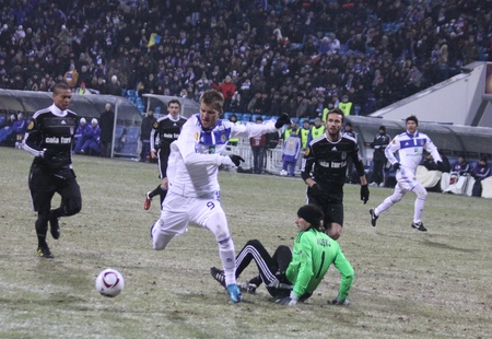 KYIV, UKRAINE - FEBRUARY 24, 2011: Andriy Yarmolenko of Dynamo Kyiv (C) scores a goal against Besiktas during their UEFA Europa League game on February 24, 2011 in Kyiv, Ukraine Stock Photo - 9020925