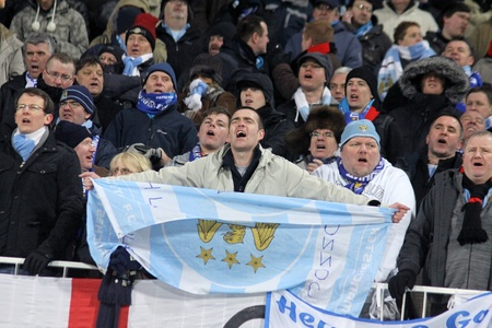 uefa: KYIV, UKRAINE - MARCH 10, 2011: FC Manchester City supporters show their support during UEFA Europa League game against FC Dynamo Kyiv on March 10, 2011 in Kyiv, Ukraine