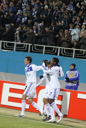scored: KYIV, UKRAINE - MARCH 10, 2011: Dynamo Kiev players celebrate after Andriy Shevchenko (2nd from R) scored against Manchester City during their UEFA Europa League game on March 10, 2011 in Kyiv, Ukraine