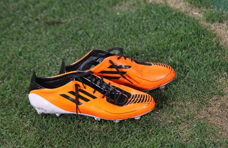Pair of football boots on the grass Stock Photo - 9216212