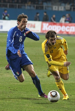 KYIV, UKRAINE - MARCH 29, 2011: Oleksandr Aliev of Ukraine (R) fights for a ball with Claudio Marchisio of Italy during their friendly match on March 29, 2011 in Kyiv, Ukraine