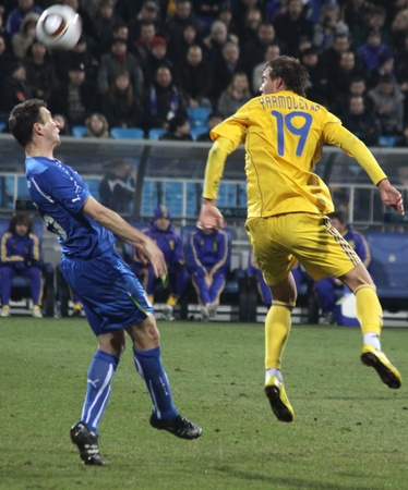 KYIV, UKRAINE - MARCH 29, 2011: Andriy Yarmolenko of Ukraine (R) fights for a ball with Daniele Gastaldello of Italy during their friendly match on March 29, 2011 in Kyiv, Ukraine