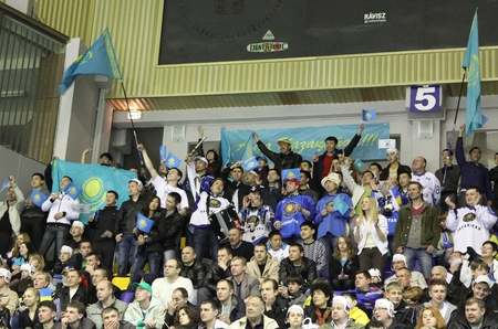 icehockey: KYIV, UKRAINE - APRIL 23, 2011: Kazakhstan fans celebrate during IIHF Ice-hockey World Championship DIV I Group B game against Ukraine on April 23, 2011 in Kyiv, Ukraine Editorial