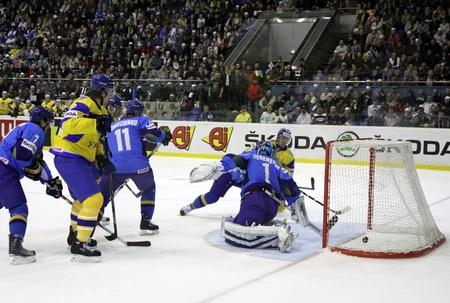 div: KYIV, UKRAINE - APRIL 23, 2011: Yuri Navarenko of Ukraine (1st from R, in yellow) scored against Kazakhstan during their IIHF Ice-hockey World Championship DIV I Group B game on April 23, 2011 in Kyiv, Ukraine Editorial