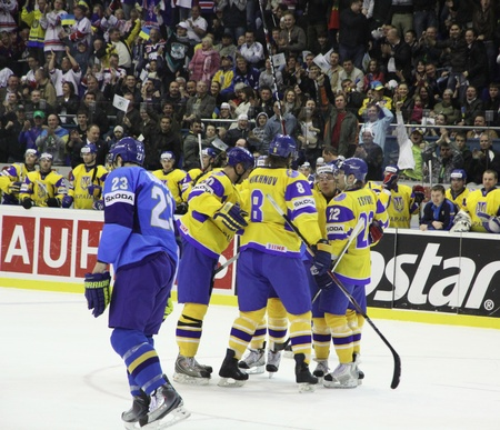 icehockey: KYIV, UKRAINE - APRIL 23, 2011: Ukraine players react after they scored against Kazakhstan during their IIHF Ice-hockey World Championship DIV I Group B game on April 23, 2011 in Kyiv, Ukraine