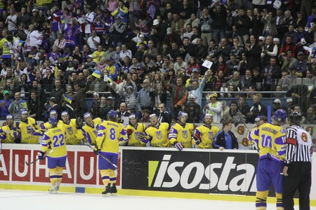 scored: KYIV, UKRAINE - APRIL 23, 2011: Ukraine players react after they scored against Kazakhstan during their IIHF Ice-hockey World Championship DIV I Group B game on April 23, 2011 in Kyiv, Ukraine