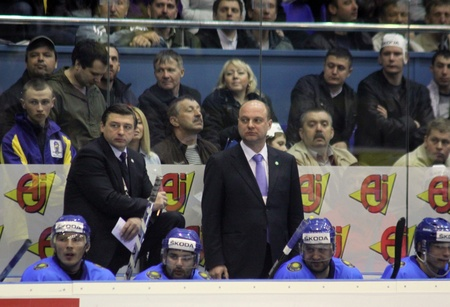 div: KYIV, UKRAINE - APRIL 23, 2011: The head coach of Kazakhstan Andrei Khomutov (L) looks on during IIHF Ice-hockey World Championship DIV I Group B game against Kazakhstan on April 23, 2011 in Kyiv, Ukraine