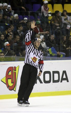 div: KYIV, UKRAINE - APRIL 23, 2011: Referee David Lewis raise his hand during IIHF Ice-hockey World Championship DIV I game between Ukraine and Kazakhstan on April 23, 2011 in Kyiv