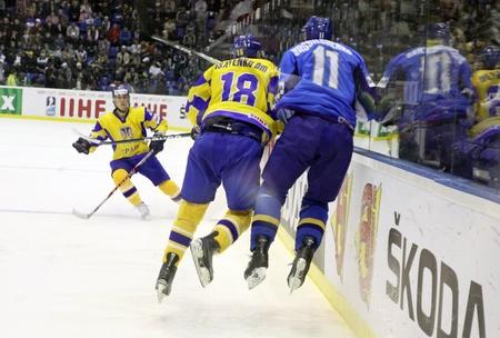 KYIV, UKRAINE - APRIL 23, 2011: Dmytro Isayenko of Ukraine (L) fights for a puck with Alexei Vassilchenko of Kazakhstan during their IIHF Ice-hockey World Championship DIV I game on April 23, 2011 in Kyiv