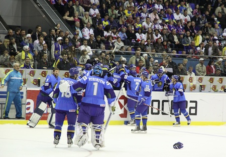 div: KYIV, UKRAINE - APRIL 23, 2011: Kazakhstan players react after they win against Ukraine during their IIHF Ice-hockey World Championship DIV I Group B game on April 23, 2011 in Kyiv, Ukraine Editorial