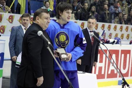 div: KYIV, UKRAINE - APRIL 23, 2011: Roman Savchenko of Kazakhstan (R) - Best Defenceman of IIHF Ice-hockey World Championship DIV I Group B on April 23, 2011 in Kyiv, Ukraine Editorial