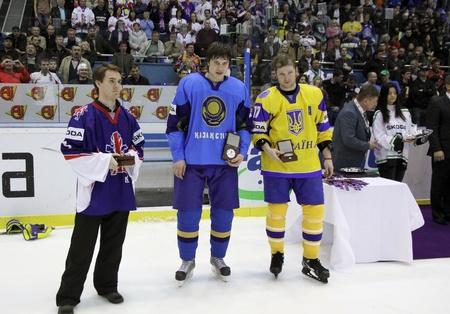 div: KYIV, UKRAINE - APRIL 23, 2011: Individual Awards of IIHF Ice-hockey World Championship DIV I Group B: Best Goalie - Stephen Murphy of Great Britain (L), Best Defenceman - Roman Savchenko of Kazakhstan (C), Best Forward - Olexander Materukhin of Ukraine o