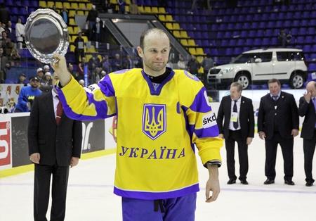 div: KYIV, UKRAINE - APRIL 23, 2011: Andriy Sryubko of Ukraine with bronze award of IIHF Ice-hockey World Championship DIV I Group B on April 23, 2011 in Kyiv, Ukraine Editorial
