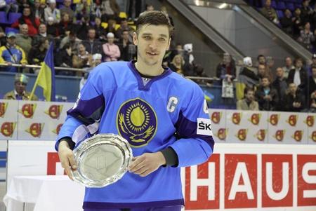 div: KYIV, UKRAINE - APRIL 23, 2011: Vitali Novopashin of Kazakhstan with gold award of IIHF Ice-hockey World Championship DIV I Group B on April 23, 2011 in Kyiv, Ukraine